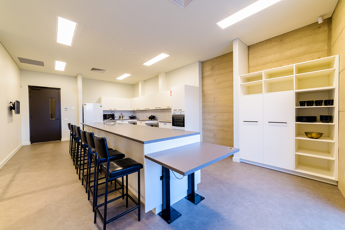 Photo of Training Kitchen highlighting adjustable benches and stoves