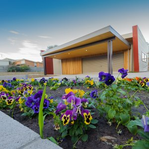 Image of Community Shed with flower garden in foreground