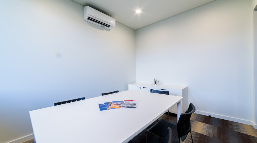 Photo of meeting room two showing table, chairs and cupboards