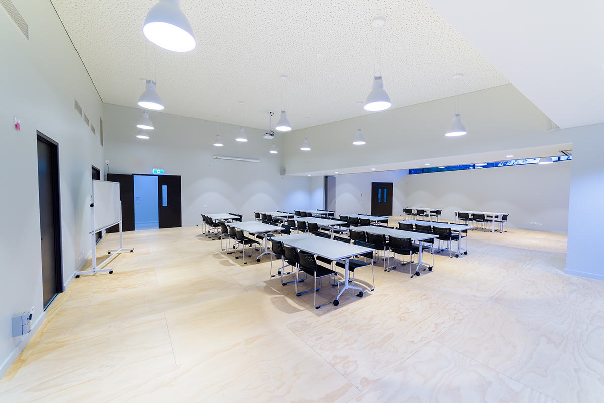 Photo of full Multipurpose room with table and chairs set up