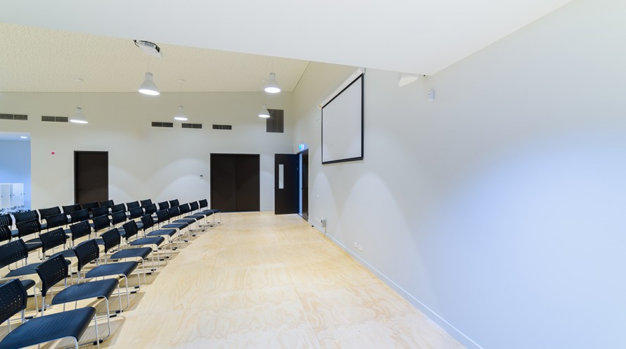 Photo of multipurpose room configured for a conference