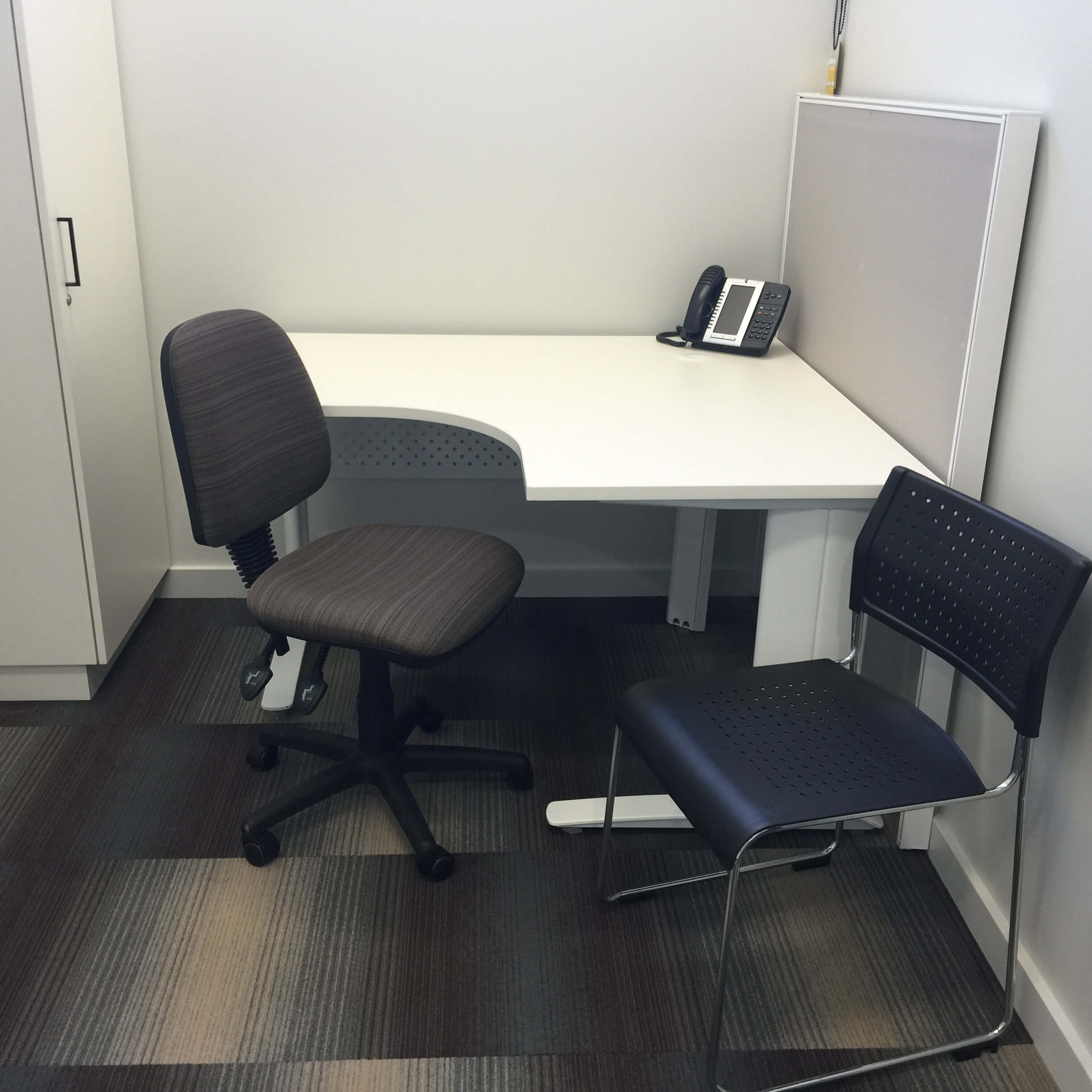Consulting room with desk and two chairs